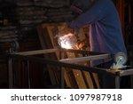 welding. a welder arc welds... | Shutterstock . vector #1097987918