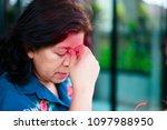 senior women with a headache... | Shutterstock . vector #1097988950