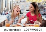 pizza time. two smiling women...   Shutterstock . vector #1097990924