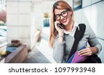 young smiling businesswoman...   Shutterstock . vector #1097993948