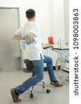 dentist stretching his legs and ... | Shutterstock . vector #1098003863