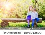 cute blond preschooler girl... | Shutterstock . vector #1098012500
