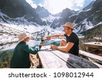 father and son hiking traveler... | Shutterstock . vector #1098012944