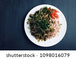 red rice with mushrooms and... | Shutterstock . vector #1098016079