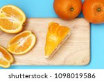 piece of orange cake | Shutterstock . vector #1098019586