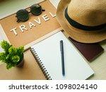 a blank spiral notebook  a pen  ... | Shutterstock . vector #1098024140
