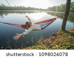 young woman by the lake hanging ... | Shutterstock . vector #1098026078
