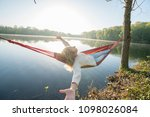 young woman by the lake hanging ... | Shutterstock . vector #1098026084