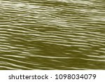 abstract background  waves on... | Shutterstock . vector #1098034079