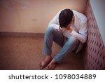 depressed man sitting head in... | Shutterstock . vector #1098034889