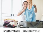 woman packing travel bag for... | Shutterstock . vector #1098034910
