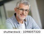 middle aged guy with trendy... | Shutterstock . vector #1098057320