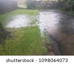 a flooded driveway and lawn | Shutterstock . vector #1098064073