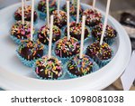 chocolate cake pops on plate. | Shutterstock . vector #1098081038