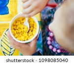 cup corn baby food in the park | Shutterstock . vector #1098085040
