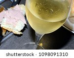 glass of champagne and baguette ... | Shutterstock . vector #1098091310
