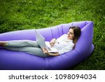 pretty young woman lying on... | Shutterstock . vector #1098094034