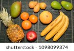 a lot of exotic fruits on a... | Shutterstock . vector #1098099374