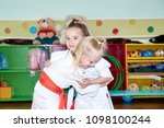 two girls sportswomen train a... | Shutterstock . vector #1098100244