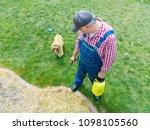man spraying grass in a... | Shutterstock . vector #1098105560