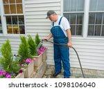 man water freshly planted... | Shutterstock . vector #1098106040