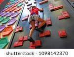 young girl  age 7  climbing on...   Shutterstock . vector #1098142370
