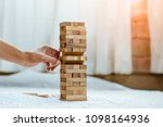 hand  pulling out or placing... | Shutterstock . vector #1098164936