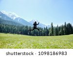 asian travelers jumping on the... | Shutterstock . vector #1098186983