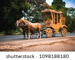 A Horse Drawn Carriage In Front ...