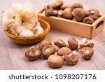 shiitake mushroom on wood table ... | Shutterstock . vector #1098207176