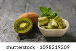 kiwi salad and mint on a white... | Shutterstock . vector #1098219209
