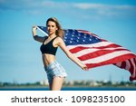 young woman with us flag . girl ... | Shutterstock . vector #1098235100