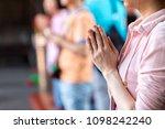 Close Up Woman Pray In Longshan ...