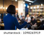 woman presenting to audience.... | Shutterstock . vector #1098265919