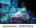 hacker using clear tablet with... | Shutterstock . vector #1098278816