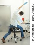 male dentist stretching his... | Shutterstock . vector #1098290660