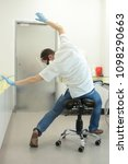 male dentist stretching his... | Shutterstock . vector #1098290663
