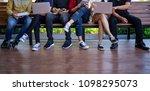 young men and women sitting... | Shutterstock . vector #1098295073