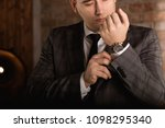 elegant businessman correcting... | Shutterstock . vector #1098295340