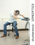 male dentist exercising in his... | Shutterstock . vector #1098297323