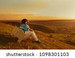 boy is playing with an airplane ... | Shutterstock . vector #1098301103