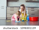 mother and baby are cleaning... | Shutterstock . vector #1098301139