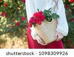 Stock photo roses in basket beautiful bush of red roses in a spring garden rose garden red roses bush 1098309926