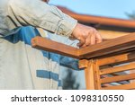 Small photo of man assemble furniture in outdoor