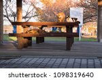 Small photo of Cats occupy the bench