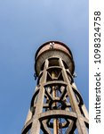 Small photo of water tank for Consume with clear sky background. Dorno, Pavia, Italy