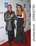Small photo of LOS ANGELES, CA - SEPTEMBER 24, 2009: Former Monkee Davy Jones & new wife Jessica Pacheco at the Macy's Passport 2009 Fashion Show at Barker Hanger, Santa Monica Airport.