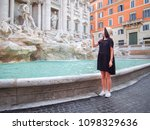 young woman throws a coin in... | Shutterstock . vector #1098329636