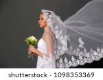 a bride with a veil on her head ... | Shutterstock . vector #1098353369