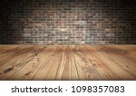 empty wooden table and brick... | Shutterstock . vector #1098357083